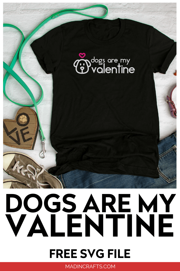 Black t-shirt that reads Dogs are my Valentine, leash, jeans and shoes