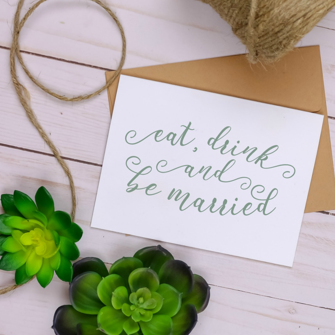farmhouse style Eat, Drink and Be Married notecard next to twine and succulents