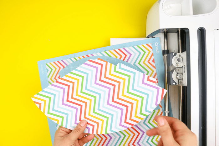 colorful scrapbook paper and a cricut maker
