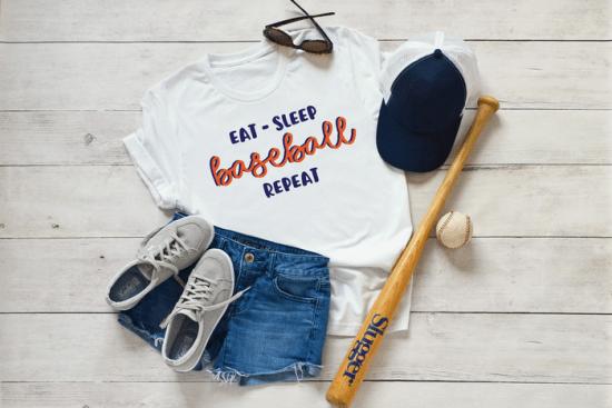 shoes, ball cap, bat, baseball, sunglasses, shoes, and t-shirt that reads Eat Sleep Baseball Repeat in vinyl
