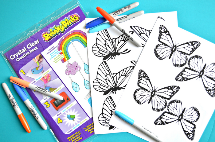 shrink plastic, sharpies, and butterfly templates