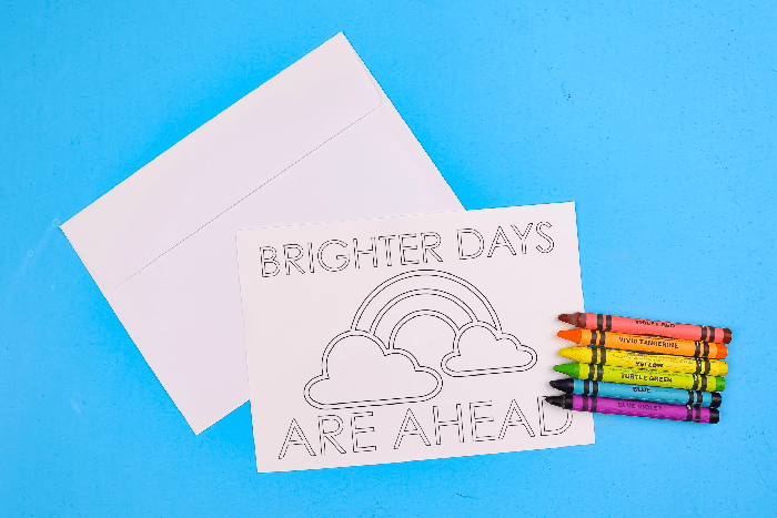coloring page greeting cards and crayons on a blue background
