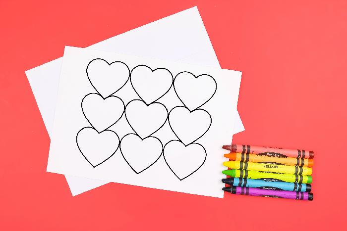 coloring page greeting cards and crayons on a red background
