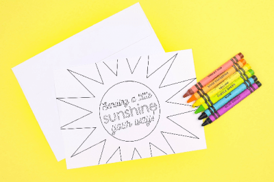 coloring page greeting cards and crayons on a yellow background