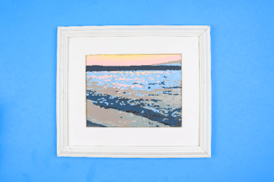 paint by number painting in a white frame on a blue background