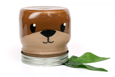 otter painted mason jar on a white background