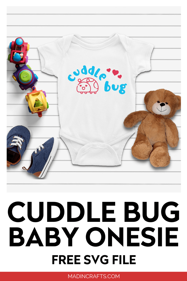 white baby onesie with a blue and pink cuddle bug SVG design next to toys