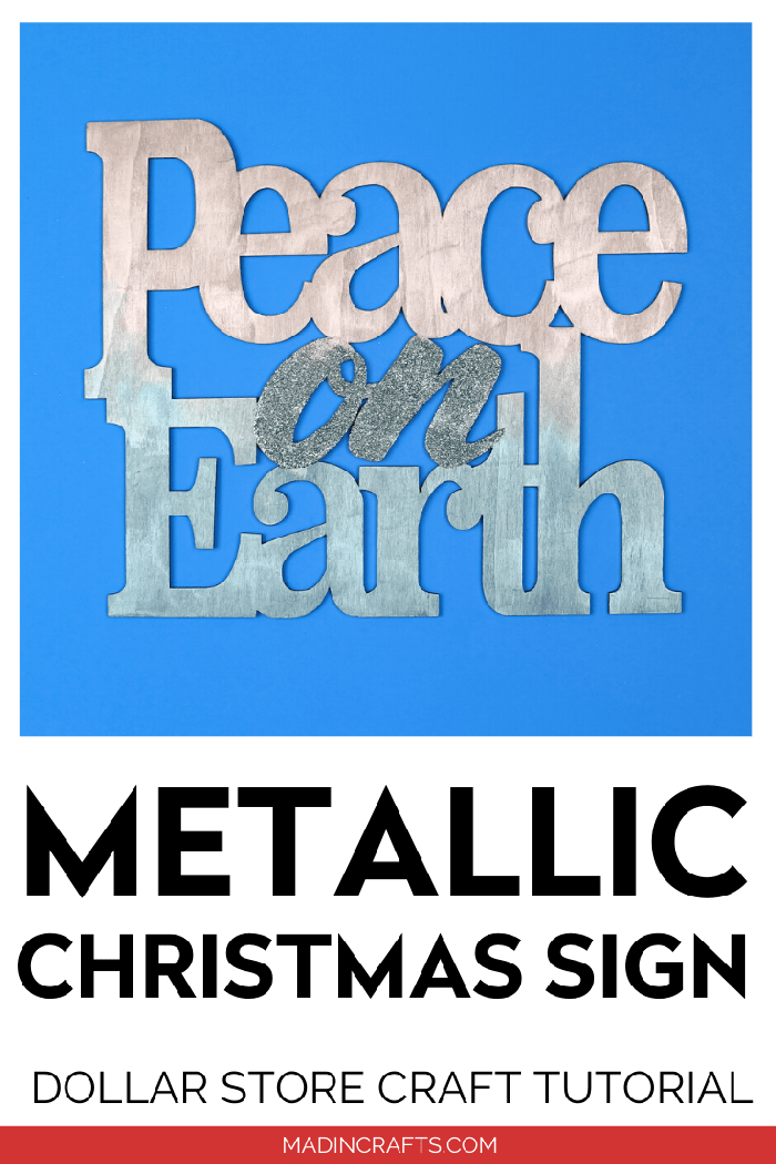 Silver and blue Peace on Earth sign on a blue background