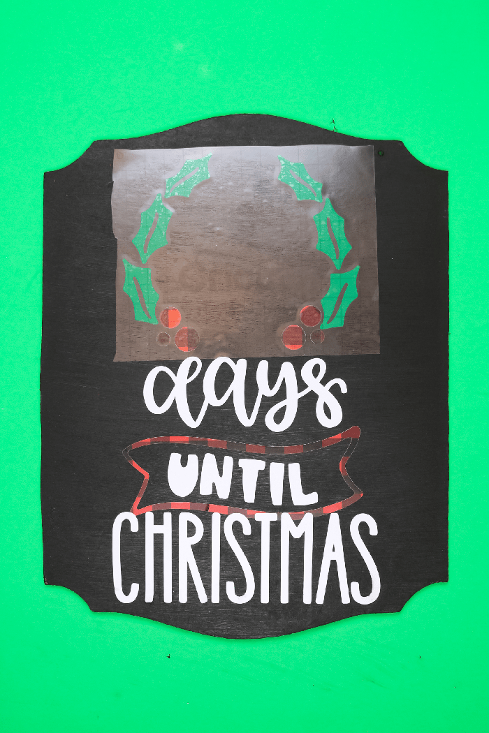 vinyl and transfer tape on a Chalkboard Days until Christmas sign on a green background