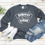 grey sweatshirt with Perfect is Boring SVG file near shoes and jeans