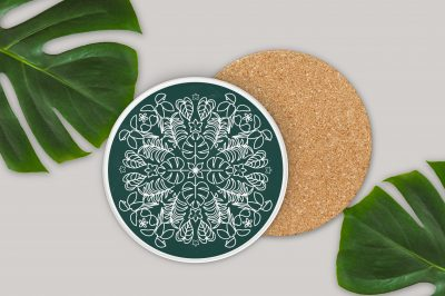 circular coasters with plant svg designs near monsterra leaves
