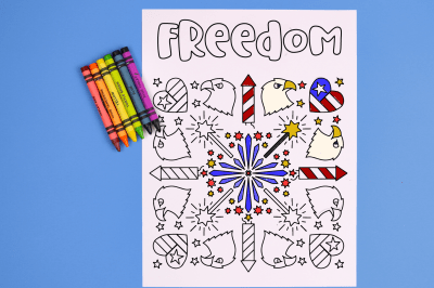 freedom coloring page with crayons on a blue background