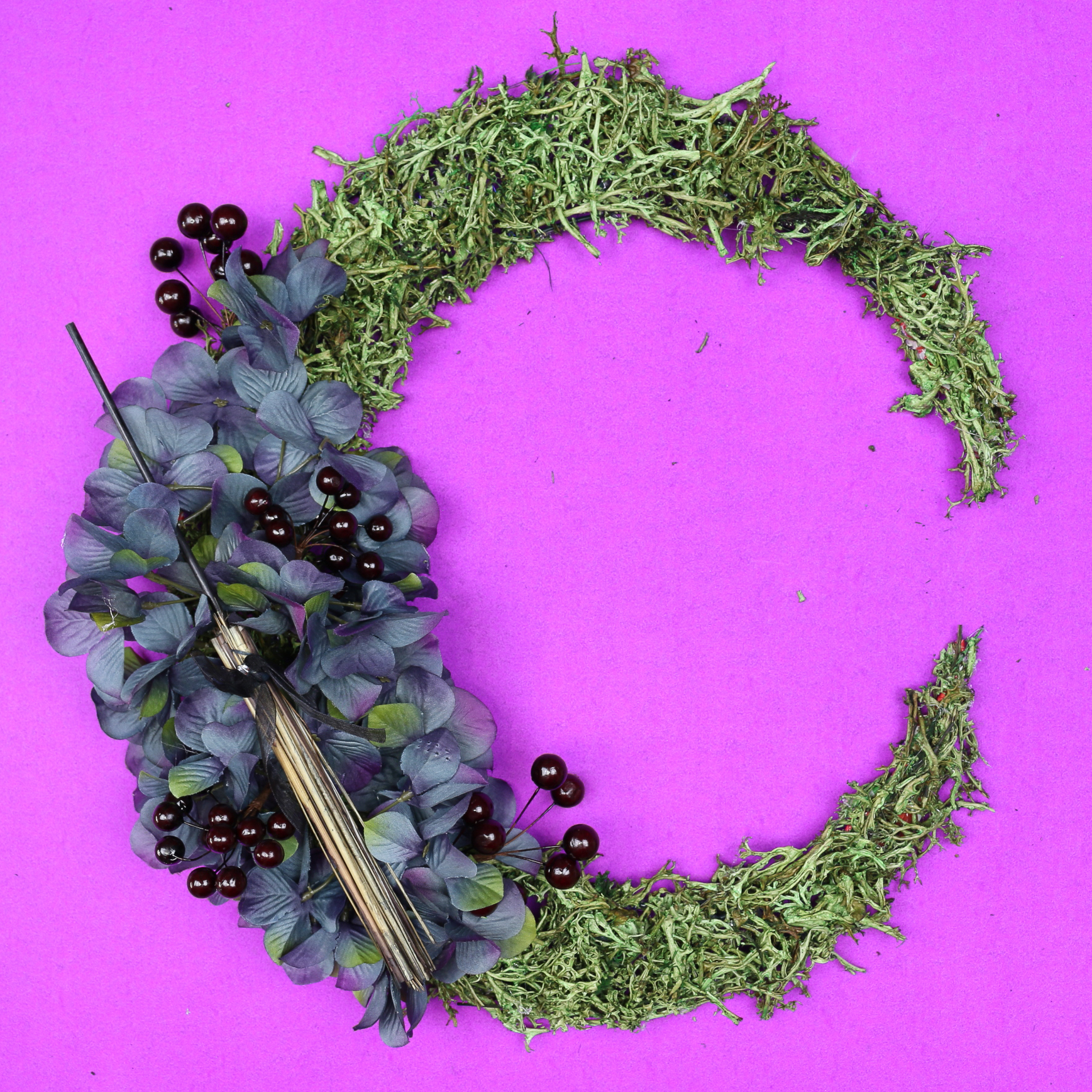 floral crescent moon wreath with halloween elements