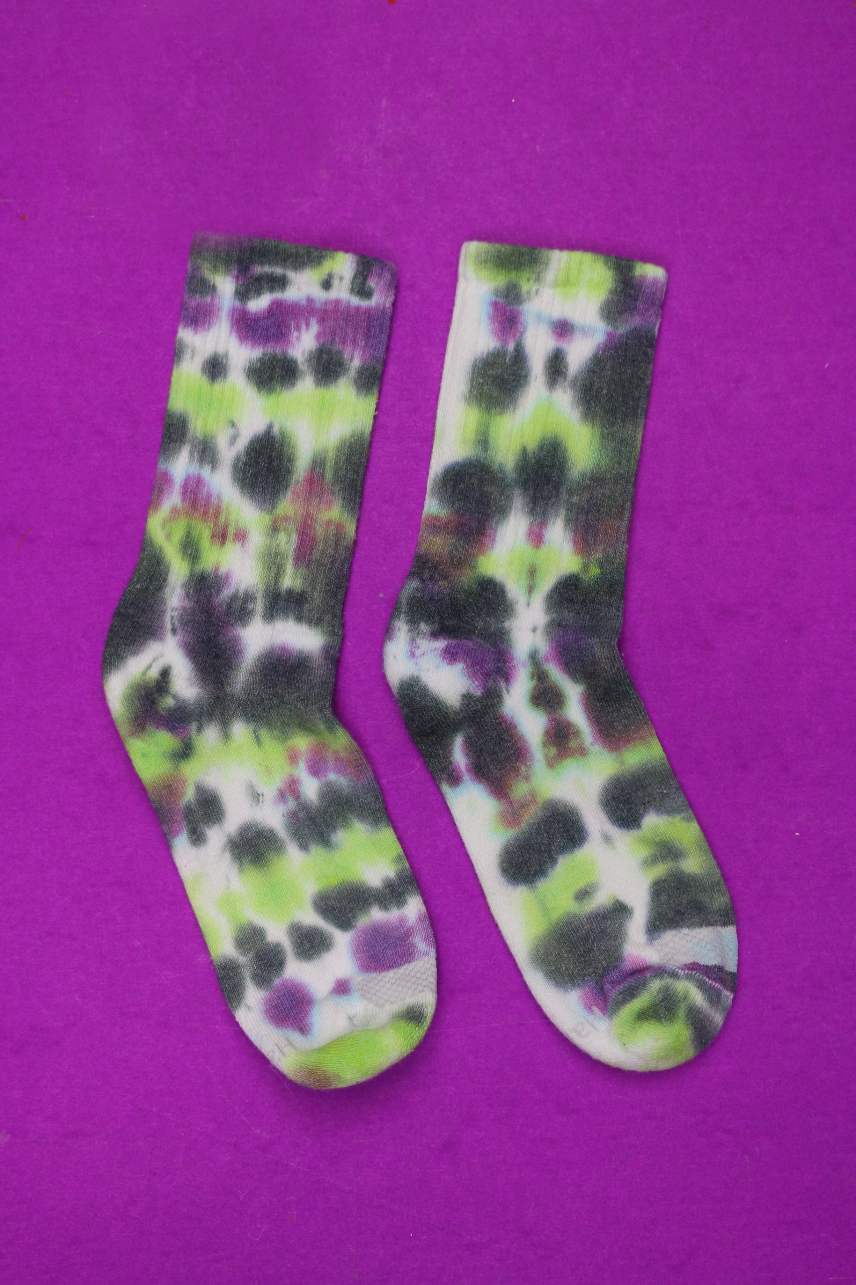 tie dyed socks on a purple background