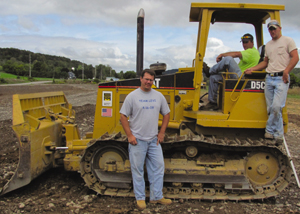 standing Carl Bartlett, Madison Co SWCD, Green shirt Everett Stone and Eli Stone DeRuyter, NY