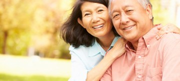Smiling elderly Asian couple