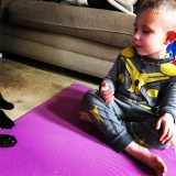 Day six of my photo challenge is something purple. Here is my boy doing yoga with me in my purple yoga mat this morning.