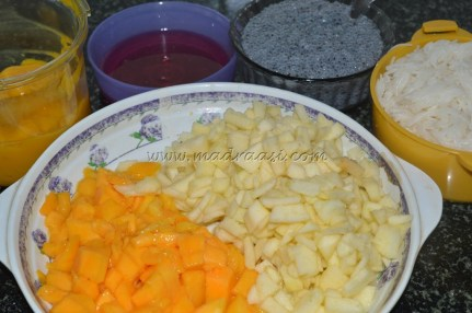 Ingredients all together (chopped apples and mangoes, mango pulp, saoked sabza seeds, boiled vermicelli, rose essence)