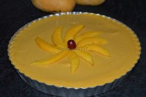 Topped with sliced mangoes and cherry - about to refrigerate