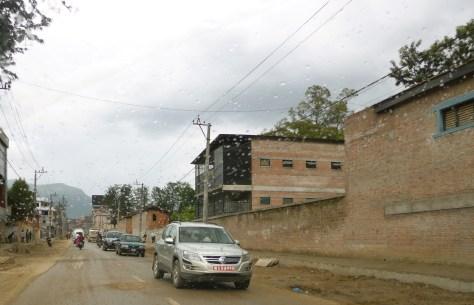 Half houses huddled together along the road.