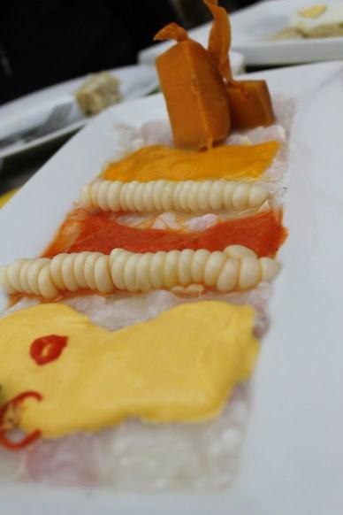 Fusion ceviche. Sashimi style fish with Peruvian sauces. At La Red.