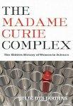 Titelbild von Madame Curie Complex (Überschrift, darunter leere Reagenzgläschen, nur eines ist mit roter Flüssigkeit gefüllt)