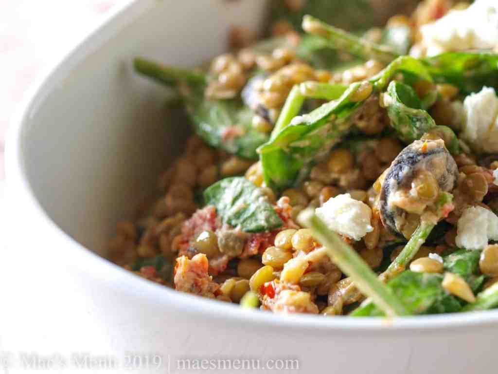 Up-close image of lentil salad with goat cheese and sundried tomatoes.