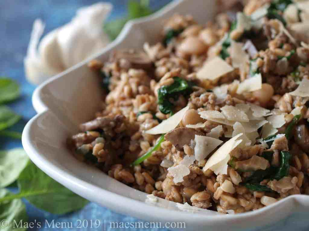 White serving bowl of mushroom farro risotto.