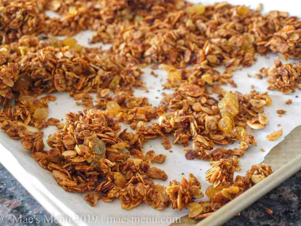 A cookie sheet full of crunchy turmeric granola recipe.