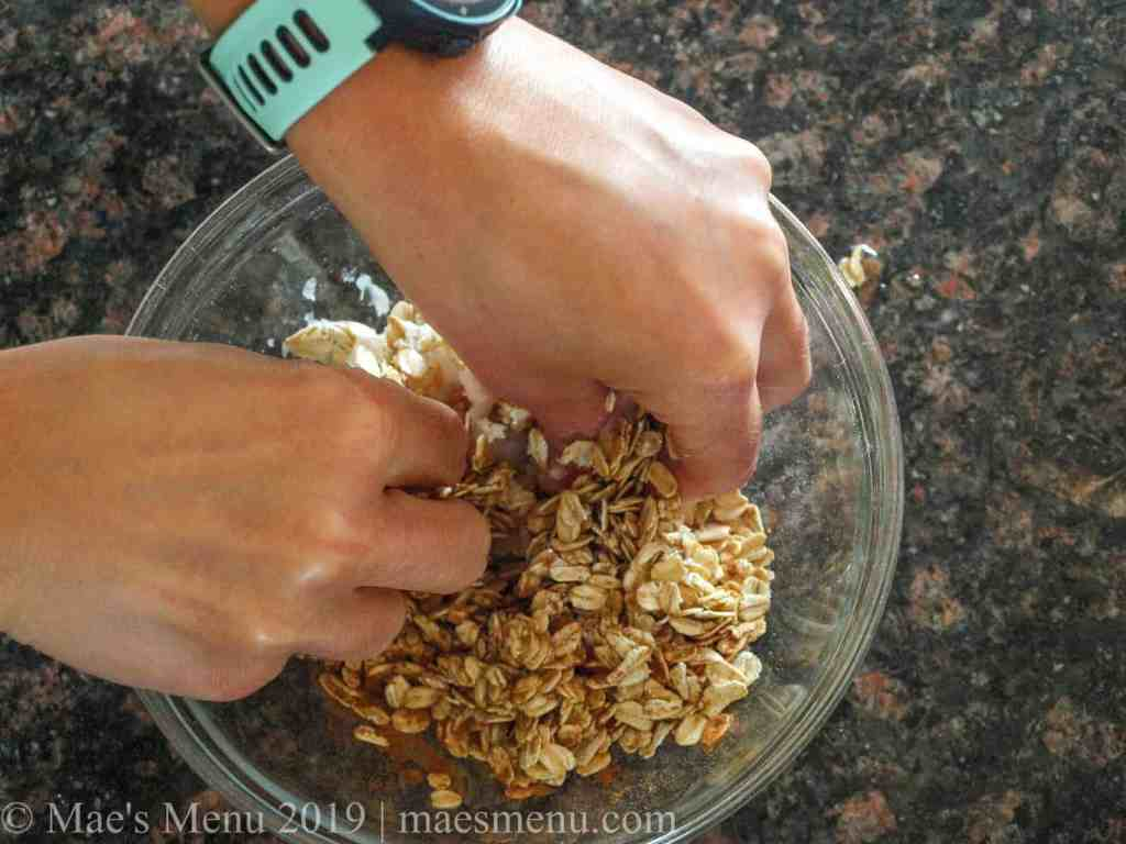 Mixing up the oatmeal and spices in a glass dish with my hands.