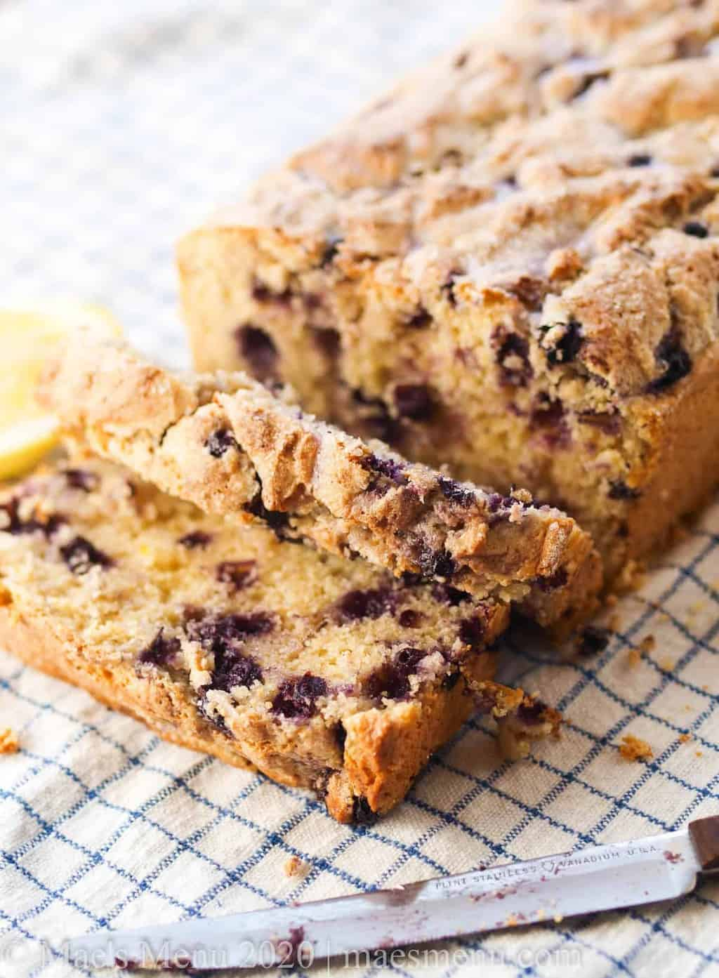 A sliced loaf of lemon blueberry muffin bread.