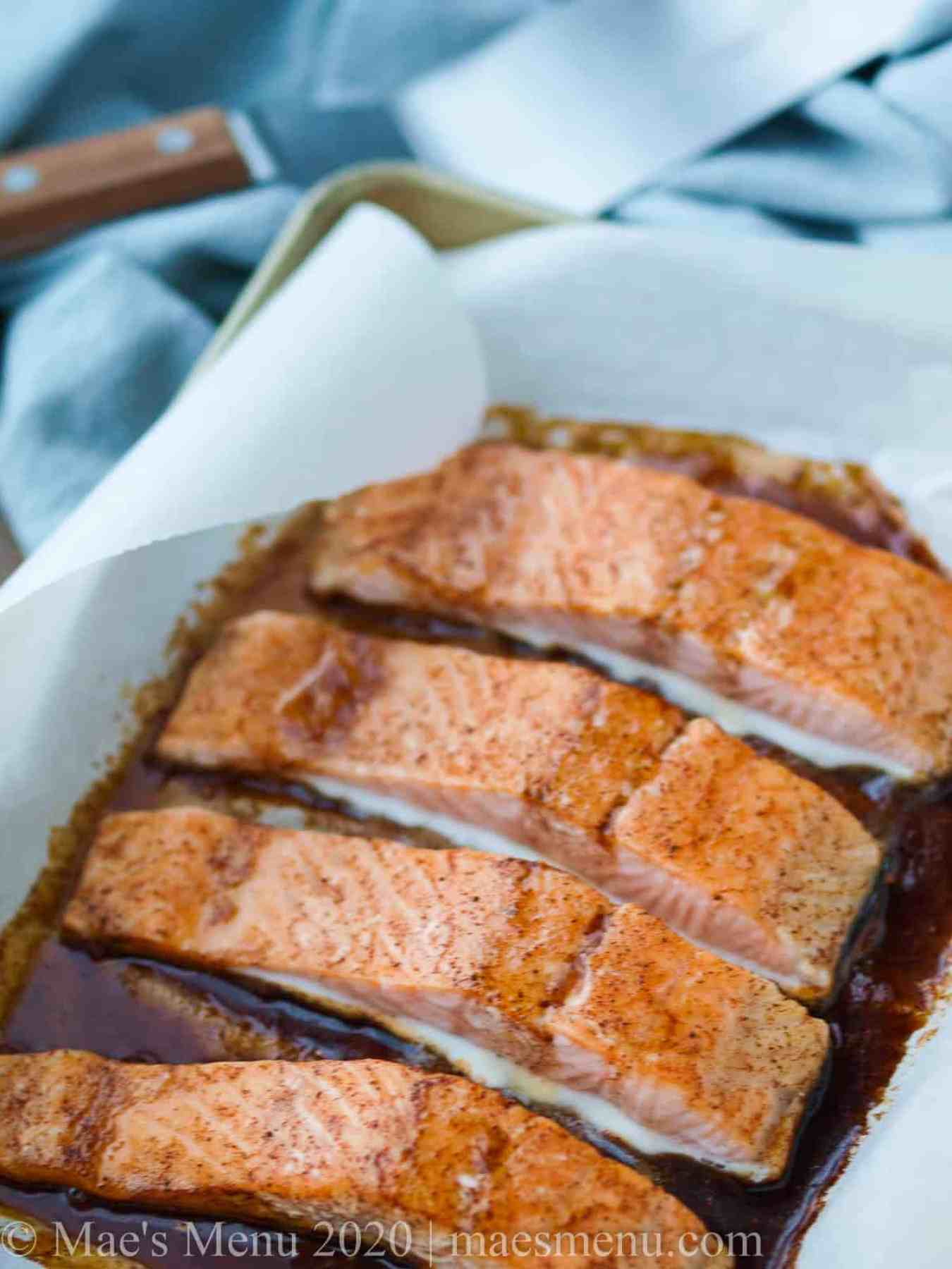 A sheet pan full of baked spicy baked glazed bourbon salmon.