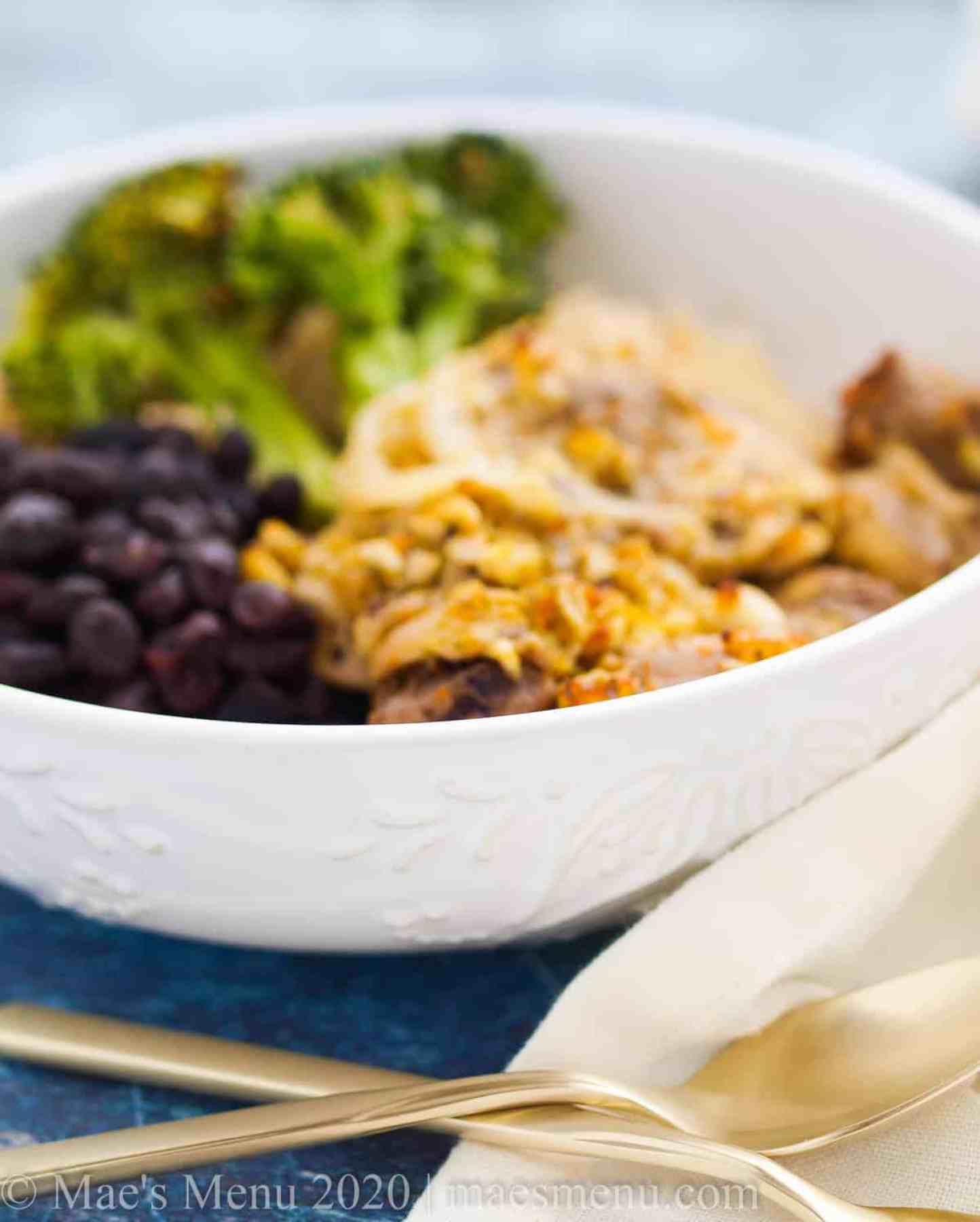 A large bowl of cuban mojo chicken and black beans.
