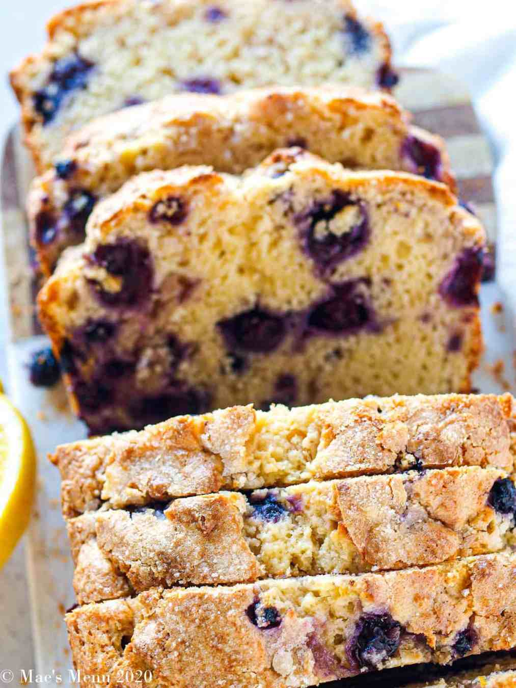 A overhead handled shot of slices of blueberry muffin bread laying on their sides.