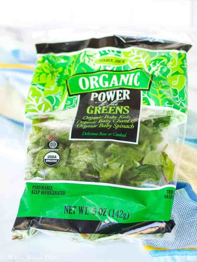 "A bag of Trader Joe's organic ""power of the greens"" baby lettuce."