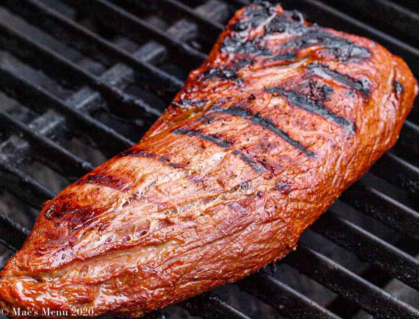 A piece of tri-tip on the grill.