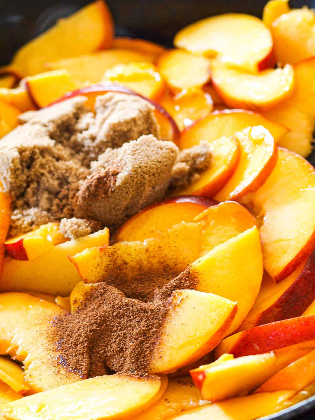 brown sugar and spices on top of peaches