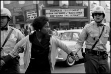 USA. Alabama. Birmingham. 1963. A female protester being arrested and led away by the police.