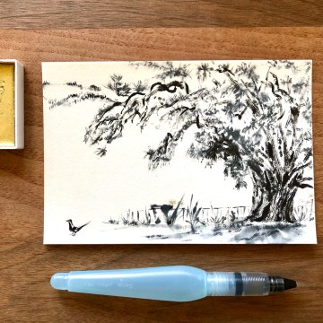 A landscape oriented postcard with a monochrome black ink pencil cedar and a small blackbird on the ground. A few gold wash highlights on the flower borders around the tree