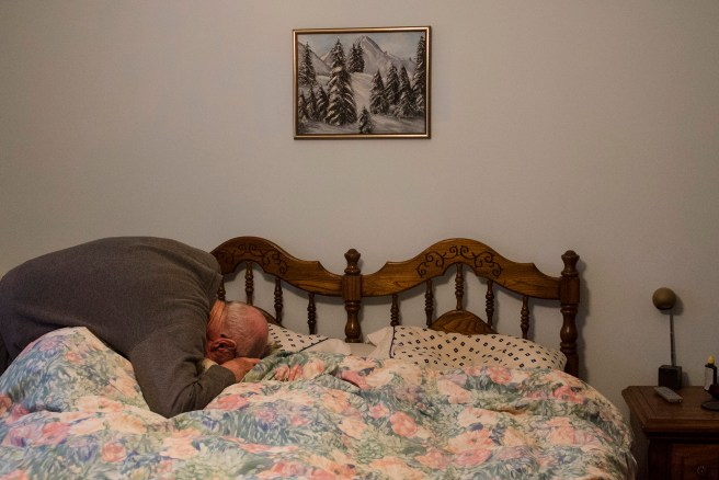 Lex Duncan wakes his wife Mary up in the morning in Trenton, Ontario. Mary was diagnosed with dementia in 2008 and Lex cared for her in their home until she died in 2015. (Photo courtesy Marta Iwanek.)