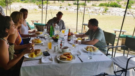 Guests enjoying lunch after morning walk in Serengeti