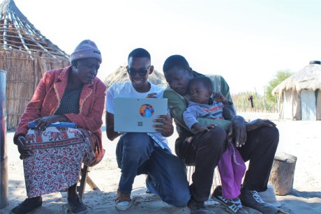Walona Sehularo of Elephants for Africa shows elephant behaviour videos to villagers © Elephants for Africa
