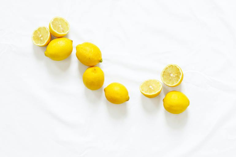 Pile of lemons, which provide vitamin C and other nutrients for healthy skin