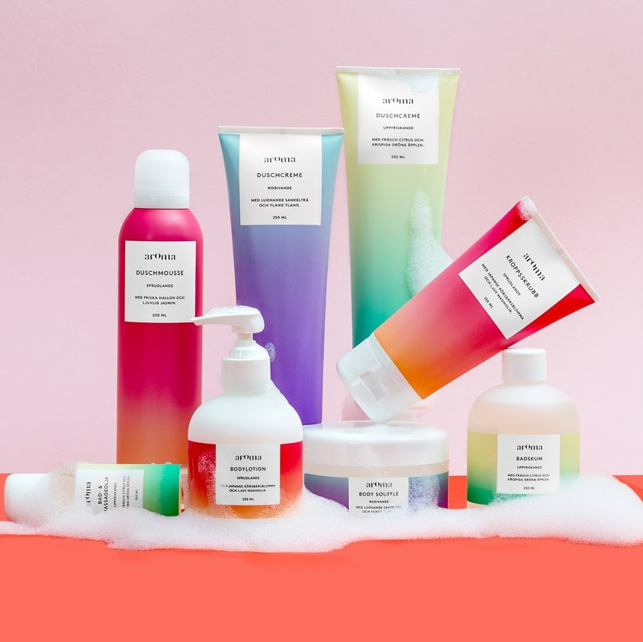 bold colors gradient effect in tubes and bottles packaging on coral table