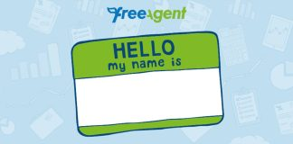 """A sticker tag with """"hello my name is"""" written on it is seen over a baby blue background."""