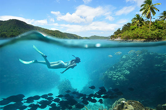 a woman snorkelling in the Maldives