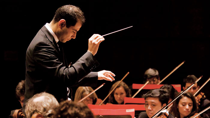 Fawzi Haimor conducts an orchestra