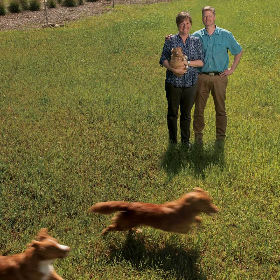 Danika and Mike Bannasch on their farm with their dogs
