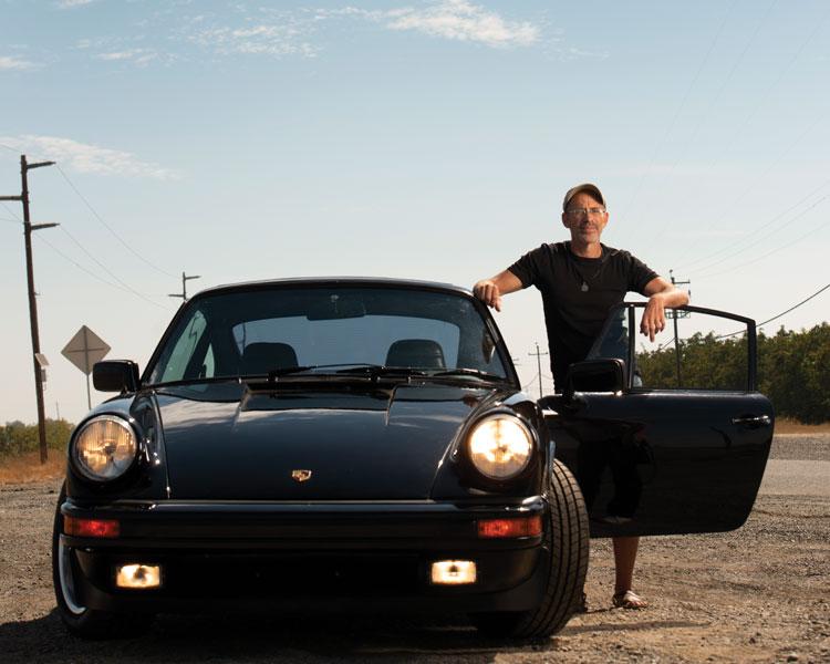 Kurt Kornbluth with a car he restored
