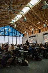 A 125-seat classroom features a wall-to-wall whiteboard, two projector screens, abundant natural light, and an epic location.